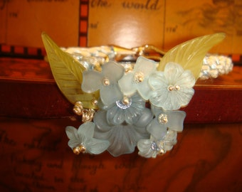 Lucite flowers on a kumihimo bracelet