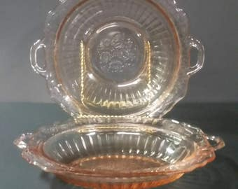 "Pink depression glass bowls.  One round one oblong. ""May Fair Open Rose""."