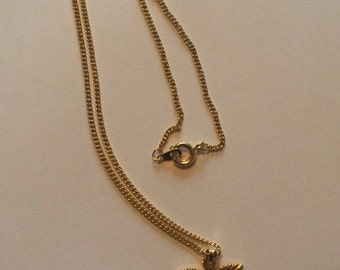 Lovely Gold tone child's butterfly necklace in gift pouch a great gift idea