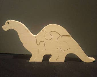 This is a scroll sawn baby bronto puzzle