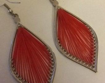 pierced leave earrings in red color