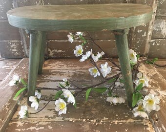 Primitive green wooden stool