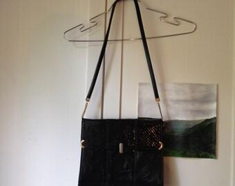 black faux snake hand bag