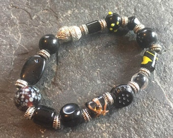 black glass and silver colored beaded stretchy bracelet