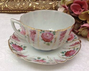 Fine porcelain hand painted teacup and saucer