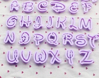 Assortment of 26 away Pieces letters Alphabet writing fairy Cake Design
