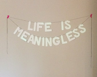 LIFE IS MEANINGLESS glitter banner in white iridescent