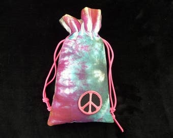 Tie dye pipe bag with peace sign