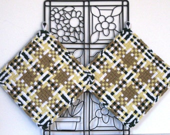 GK's Kitchen - One Pair Jumbo Brown Yellow Green and White Plaid Potholders.   Item # GK's Kitchen - Winter 00401