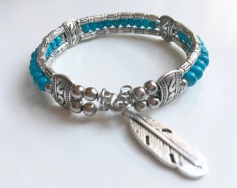 Boho Arizona dream engraved silver bracelet adorned with a silver feather turquoise beads and