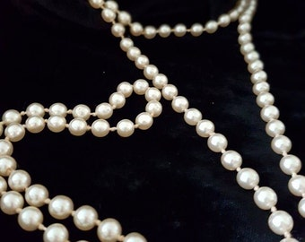 Over a metre strand of faux knotted pearls