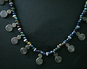 Traditional Moroccan necklace with colorful glass beads and metal spirals