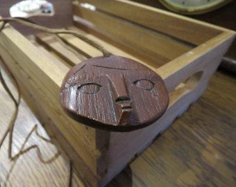 Retro ethnic wood and leather pendant