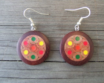 Wooden earrings (red narrated and colored pencils)