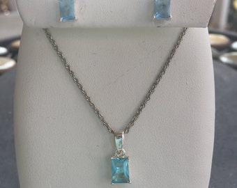 Silver and blue topaz set