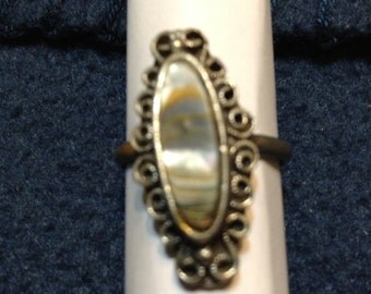 Vintage signed Vogue silver tone oval ring.
