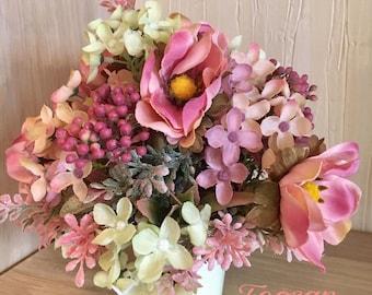 table arrangement of artificial flowers