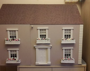 Nine room doll house, fully furnished and decorated