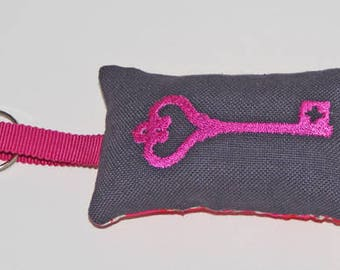 Pink embroidered key ring