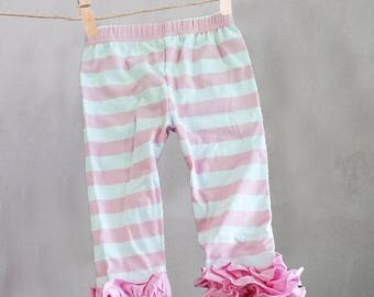 Girls' pink ruffle pants with pink stripes.