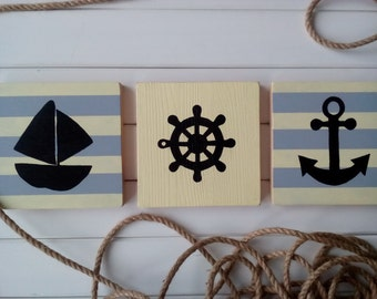 Wooden plaque on the wall in a marine style
