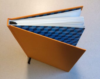 Hand bound A5 blank Journal notebook full orange bookcloth cover with made end papers using blue decorative paper hardback bookbinding