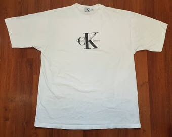 Vintage 90's CALVIN KLEIN JEANS cK Big Logo White T-Shirt Sz S Made in Canada