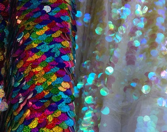 Paillette circle iridescent and multi sequins on stretch mesh base. Sold by the yd ships worldwide from Los Angeles CA