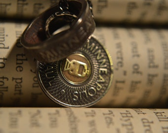 Minneapolis-St.Paul vintage transit token ring with both original token and chain included.