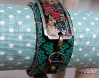Embossed leather cuff with buckle closure