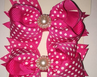 Hot pink and white polka dot shoe bows that come with a magnetic snap to attach to SASSAFLATS shoes they can also be worn in the hair