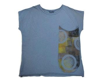 Unique t-shirt. T-shirt with pocket. Original t-shirt. Textile decoration. Eco textile. Ethnic design. Blue. Ocher tones. Vegan fashion.