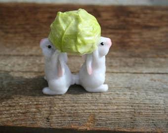 Bunnies holding lettuce fairy garden doll house figurine