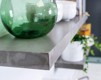 Polished concrete floating shelves