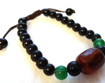 Adjustable Beaded Bracelet: black, green, brown.