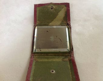 Vintage handbag or pocket mirror with a bevelled edge and fold over case, popper closure.