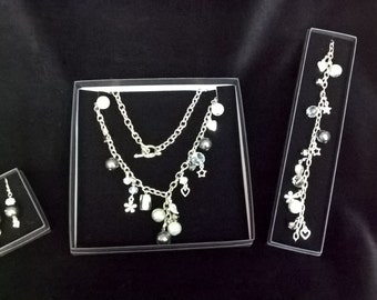 Charm necklace with silver plated charms and pewter coloured beads