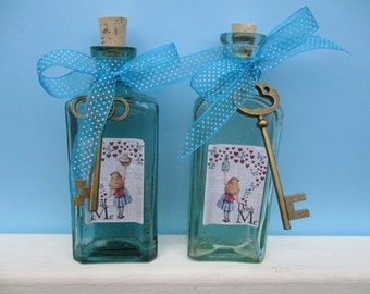 "2 "" alice in wonderland "" themed vintage bottles drink me / eat me"