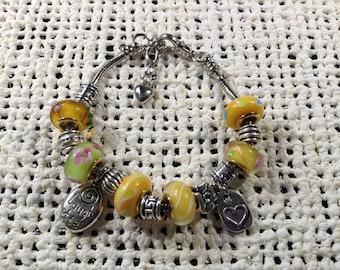 Yellow glass bead silver charm bracelet