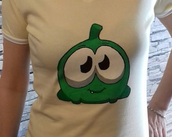 "T-shirt with hand painted ""om nom"""