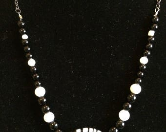 Glass zebra style pedant beaded necklace with black and white beads and black chain