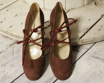 Burgundy suede shoes with leather laces. New deadstock. Measures 38 1/2 and 36 and