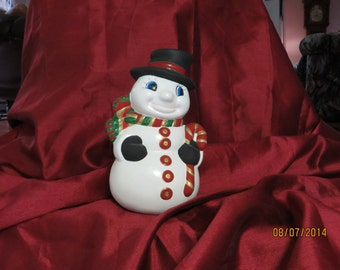 Snowman with red cane