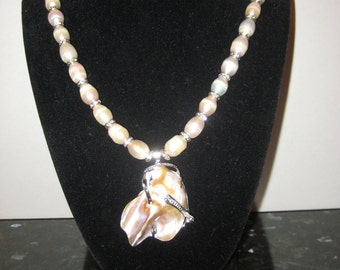 Beautiful pearl necklace with shell pendant