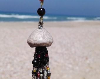 Handmade ceramic beaded jellyfish necklace with hamsa.