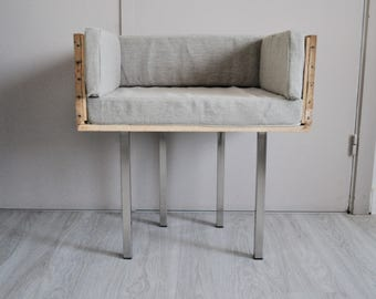 Armchair with wood box and linen