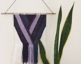 Hand woven wall hanging purple