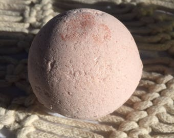 Rose clay bath bomb with grapefruit and joy. Made with 100% pure essential oils. Bath bomb for kids
