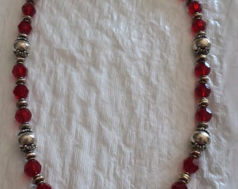 Ruby Red Swarovski crystals with sterling silver clasp.