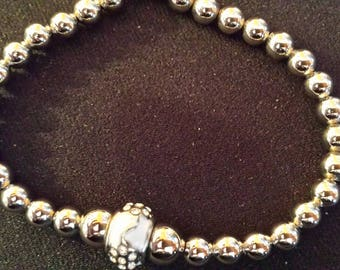 Silver and white bracelet with Rhine stones insertion